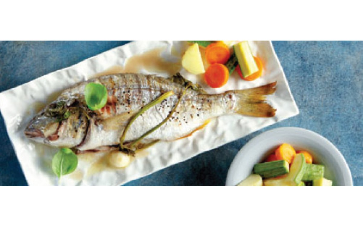 Seabream with aromatic sauce and vegetables
